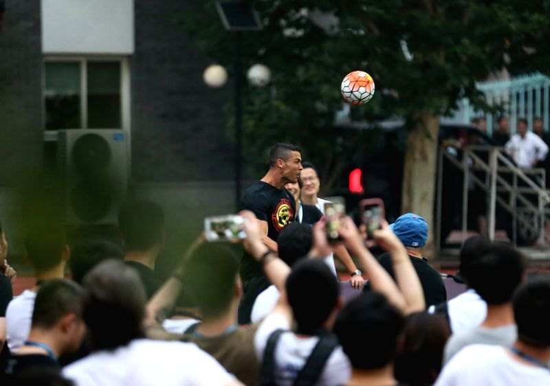 BEIJING, July 19, 2018 - Portuguese football player Cristiano Ronaldo interacts with students as he attends a promotional event in Beijing, China, on July 19, 2018.