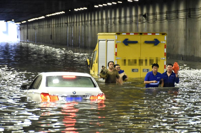 BEIJING, July 20, 2016 - Owners of the stranded vehicles leave the flooded tunnel outside the Beijing West Railway Station in Beijing, capital of China, July 20, 2016. Beijing's meteorological bureau ...
