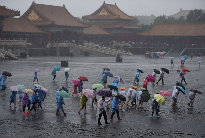 BEIJING, July 20, 2016 - Tourists visit the Forbidden City in rain in Beijing, capital of China, July 20, 2016. Beijing's meteorological bureau issued an orange alert for rainstorm Wednesday noon.