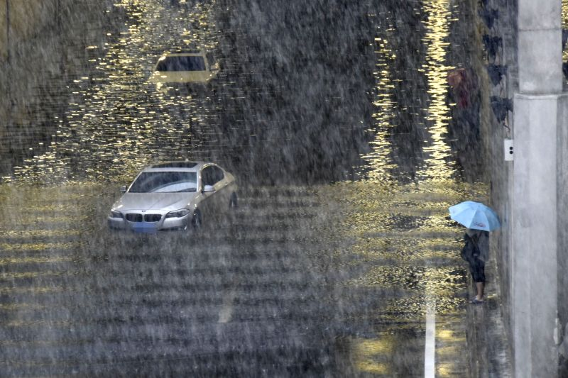 BEIJING, July 20, 2016 - Vehicles are stranded in water at a flooded tunnel outside the Beijing West Railway Station in Beijing, capital of China, July 20, 2016. Beijing's meteorological bureau ...