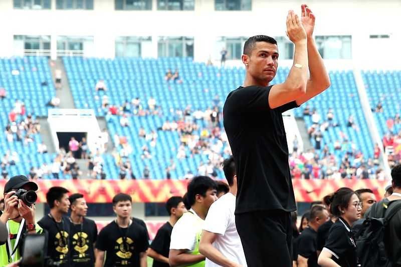 BEIJING, July 20, 2018 - Portuguese football player Cristiano Ronaldo greets the fans as he attends a promotional event in Beijing, China, on July 20, 2018.
