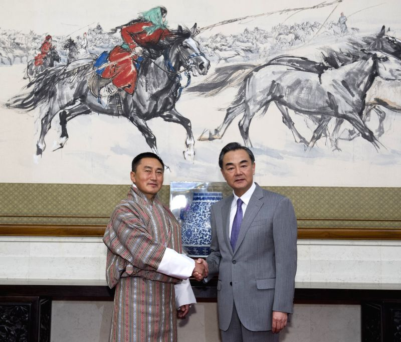 Chinese Foreign Minister Wang Yi (R) meets with his Bhutanese counterpart Rinzin Dorje in Beijing, capital of China, July 28, 2014.
