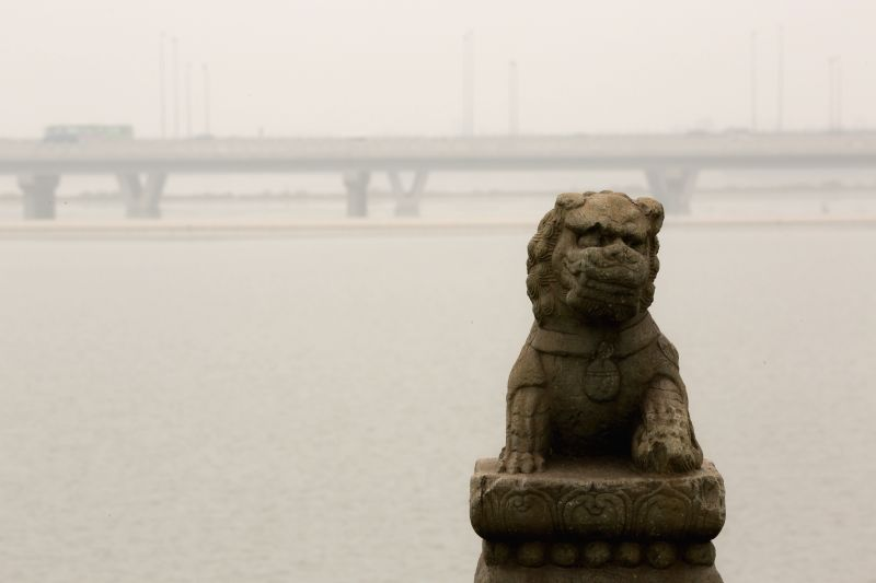 Fog shrouds the Lugou Bridge in Beijing, capital of China, July 3, 2014. Fog and smog hit Beijing on July 3 and serious pollution was reported by local environmental