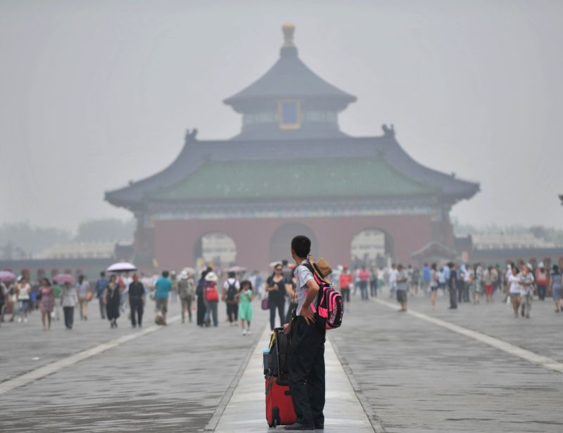 Fog shrouds the Temple of Heaven in Beijing, capital of China, July 3, 2014. Fog and smog hit Beijing on July 3 and serious pollution was reported by local ...