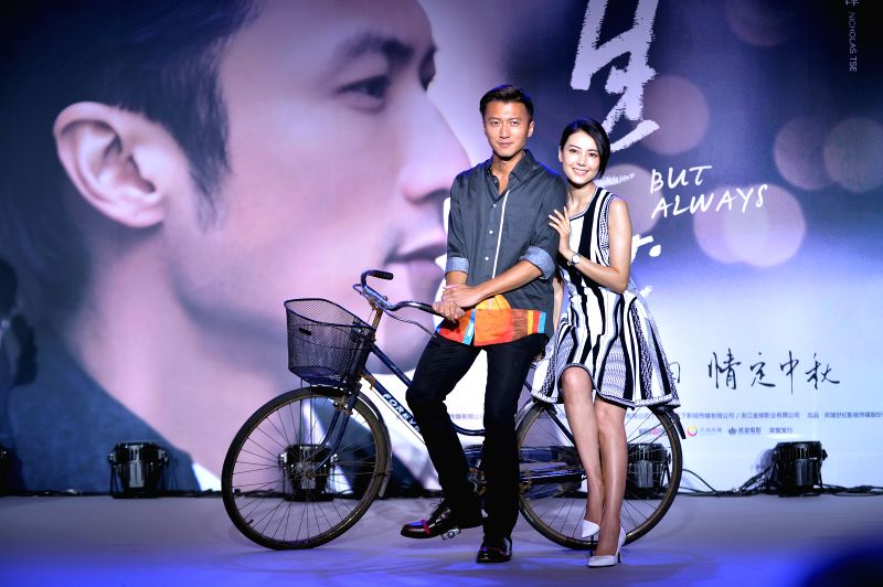 "Actors Nicholas Tse (L) and Gao Yuanyuan pose for photo at a press conference of the film ""But Always"" in Beijing, capital of China, July 31, 2014. The ... - Nicholas Tse"