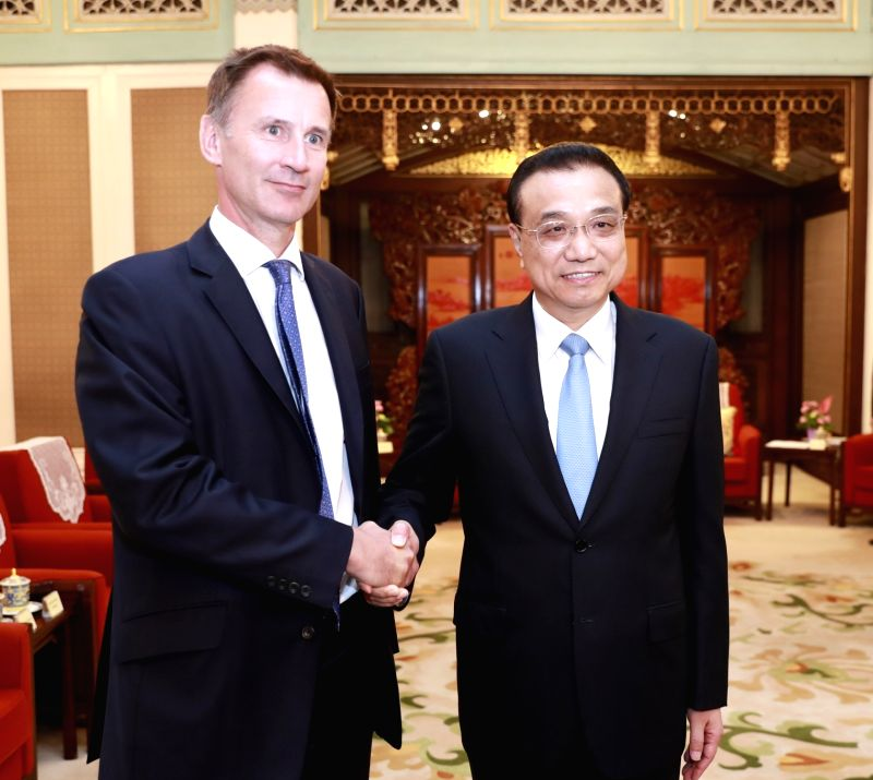 BEIJING, July 31, 2018 - Chinese Premier Li Keqiang (R) meets with British Foreign Secretary Jeremy Hunt in Beijing, capital of China, July 30, 2018.