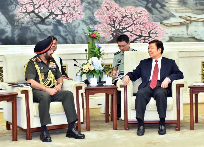 Chinese Vice President Li Yuanchao (R, front) meets with Indian Army Chief General Bikram Singh (L, front), who is also chair of the committee of chiefs of staff of .