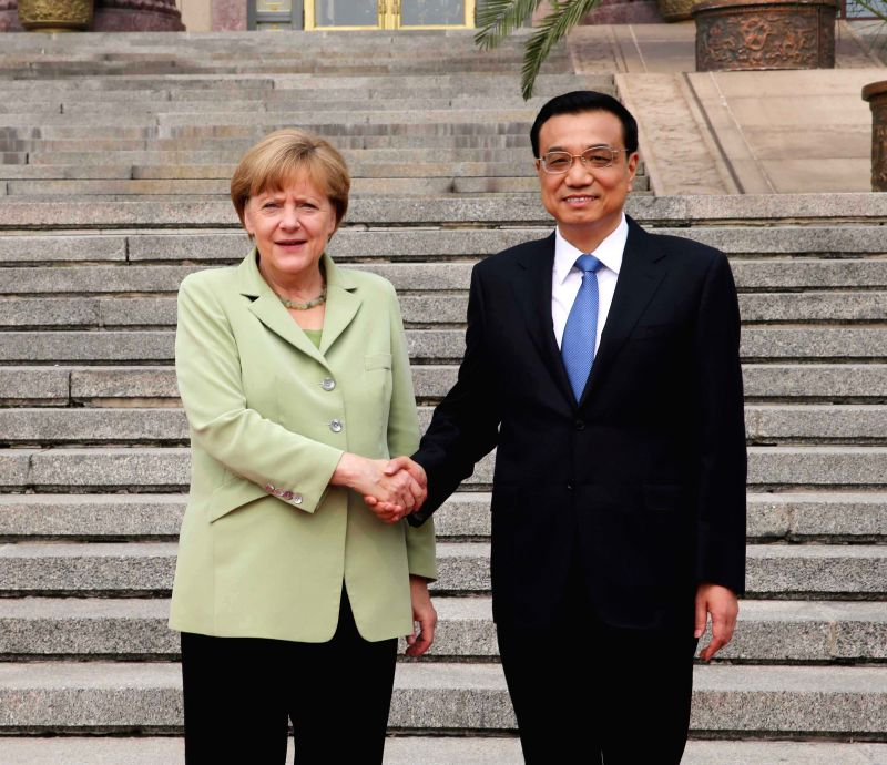 Chinese Premier Li Keqiang (R) shakes hands with German Chancellor Angela Merkel in Beijing, capital of China, July 7, 2014. Li and Merkel held talks later on ...