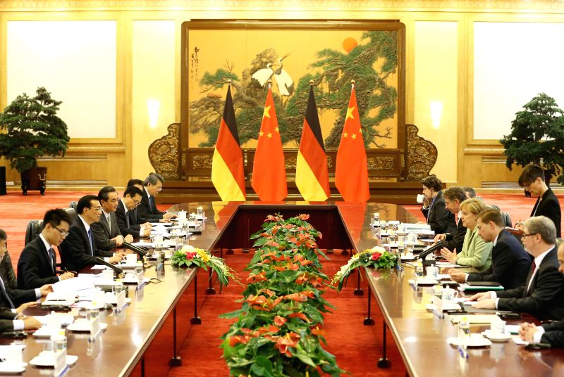 Chinese Premier Li Keqiang (2nd L) holds talks with German Chancellor Angela Merkel (3rd R, front) in Beijing, capital of China, July 7, 2014.