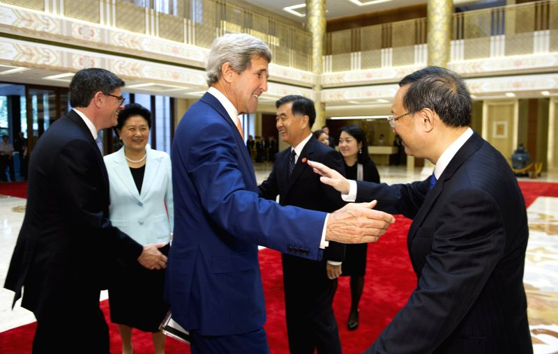 Chinese Vice Premier Liu Yandong (2nd L), Vice Premier Wang Yang (4th L) and State Councilor Yang Jiechi (1st R) greet U.S. Secretary of State John Kerry (3rd L)and .