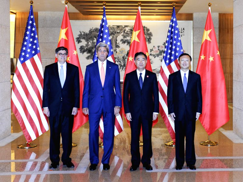 Chinese Vice Premier Wang Yang (2nd R), State Councilor Yang Jiechi (1st R), U.S. Secretary of State John Kerry (2nd L) and Treasury Secretary Jacob Lew pose for ...