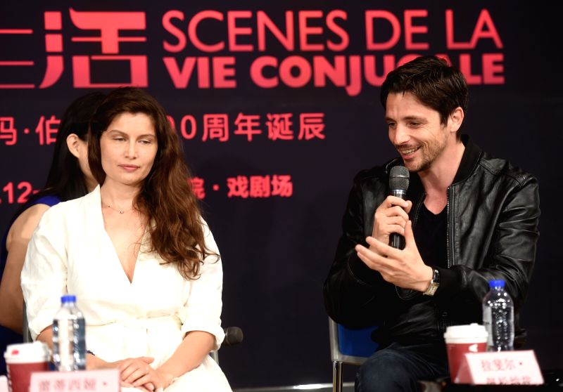 "BEIJING, June 11, 2018 - Actress Laetitia Casta (L) and actor Raphael Personnaz attend a salon of the drama ""Scenes De La Vie Conjugale"" at the National Center for the Performing Arts in ... - Laetitia Casta"