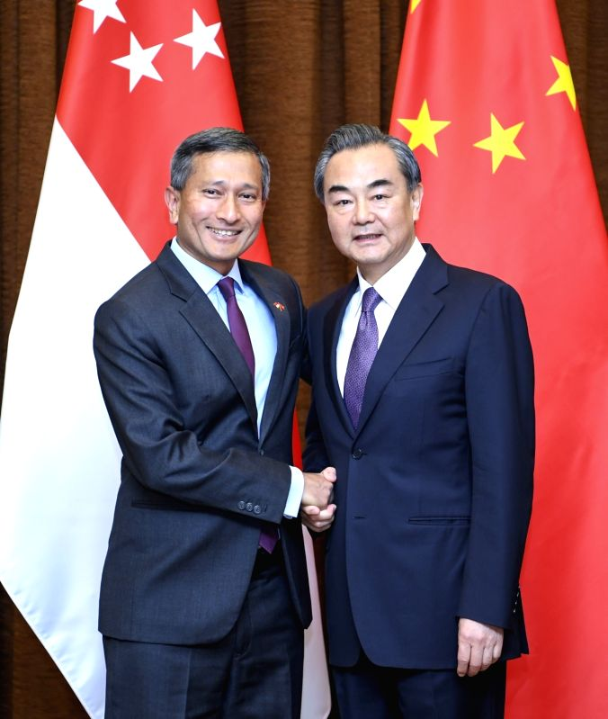 BEIJING, June 12, 2017 - Chinese Foreign Minister Wang Yi (R) holds talks with his Singaporean counterpart Vivian Balakrishnan in Beijing, capital of China, June 12, 2017. - Wang Y
