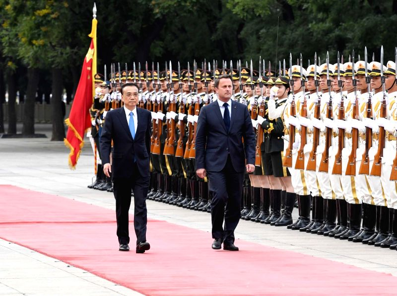 BEIJING, June 12, 2017 - Chinese Premier Li Keqiang (L) holds a welcome ceremony for Luxembourg Prime Minister Xavier Bettel before their talks in Beijing, capital of China, June 12, 2017. - Xavier Bettel