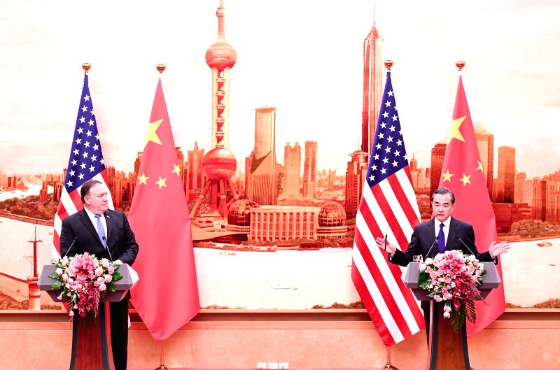 BEIJING, June 14, 2018 - Chinese State Councilor and Foreign Minister Wang Yi and U.S. Secretary of State Mike Pompeo meet the press after their talks in Beijing, capital of China, June 14, 2018. - Wang Y