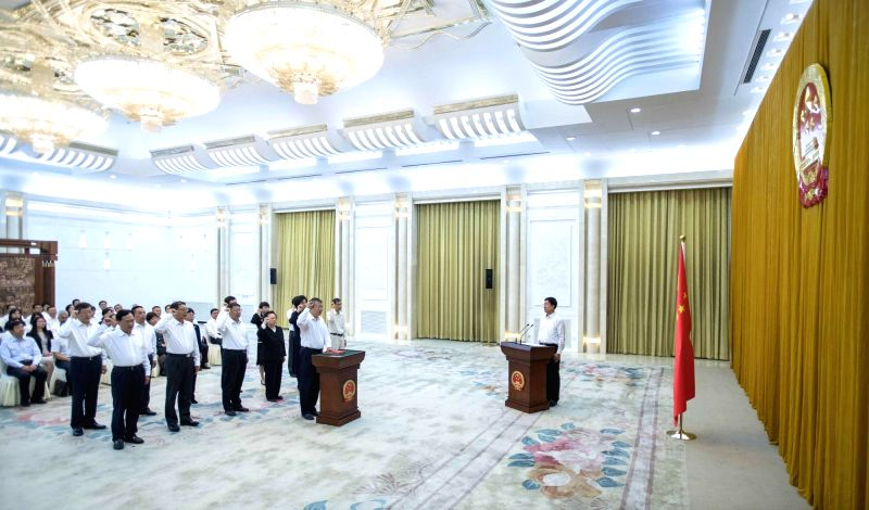 BEIJING, June 22, 2018 - Cao Jianming (1st R), vice chairman of the National People's Congress (NPC) Standing Committee, presides over an oath-taking ceremony for newly appointed officials to pledge ...