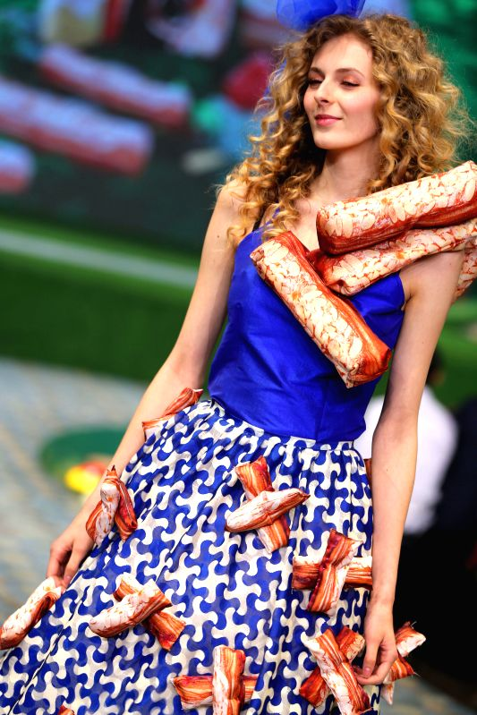 BEIJING, June 3, 2017 - A model presents a bread-inspired creation during a fashion show in Beijing, capital of China, June 2, 2017.