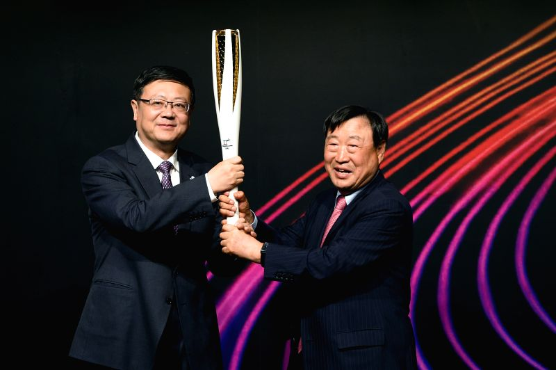 BEIJING, June 5, 2018 - Chen Jining (L), mayor of Beijing, receives the PyeongChang Olympic torch from Lee Hee-beom, president of PyoengChang 2018 Organizing Committee, during the closing ceremony of ...