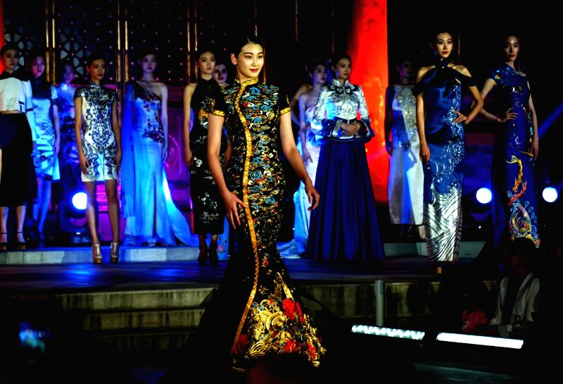 BEIJING, June 6, 2017 - A model presents a creation of Suzhou embroidery from designer NE·TIGER during a fashion show on China intangible cultural heritage at Prince Gong's Mansion in Beijing, ...