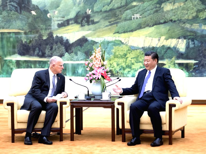 BEIJING, June 6, 2017 - Chinese President Xi Jinping  (R) meets with visiting California Governor Jerry Brown of United States at the Great Hall of the People in Beijing, capital of China, June 6, ...