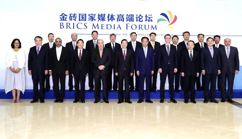 BEIJING, June 8, 2017 - Liu Qibao (C), member of the Political Bureau of the Communist Party of China (CPC) Central Committee and head of the committee's Publicity Department, poses for a group photo ...