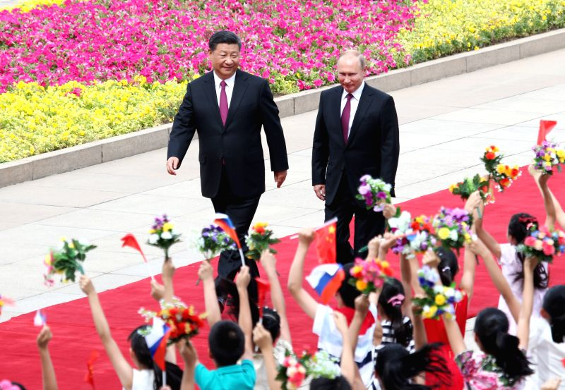 BEIJING, June 8, 2018 - Chinese President Xi Jinping holds a welcome ceremony for his Russian counterpart Vladimir Putin before their talks in Beijing, capital of China, June 8, 2018.
