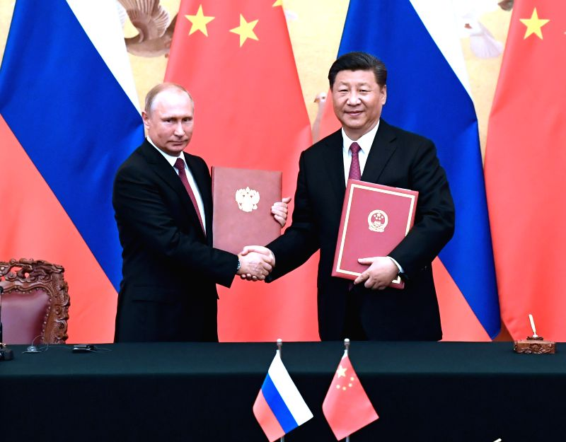 BEIJING, June 8, 2018 - Chinese President Xi Jinping and his Russian counterpart Vladimir Putin sign a joint statement after their talks in Beijing, capital of China, June 8, 2018.