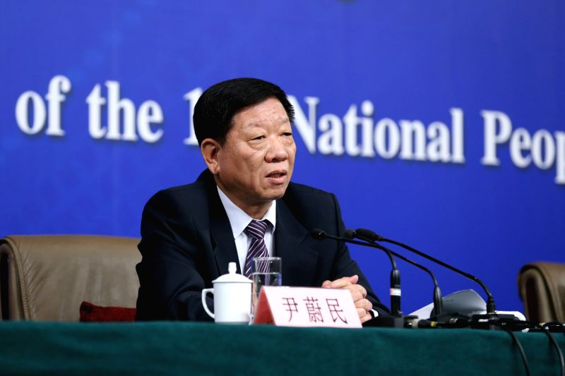 Yin Weimin, minister of human resources and social security, gives a press conference during the third session of China's 12th China's National People's Congress ...