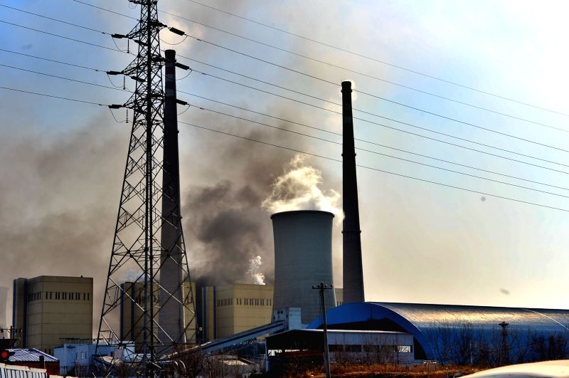 Smoke rises from a burning power plant in east Beijing, capital of China, March 13, 2015. By far, the fire has been brought under control. No causualties were ...