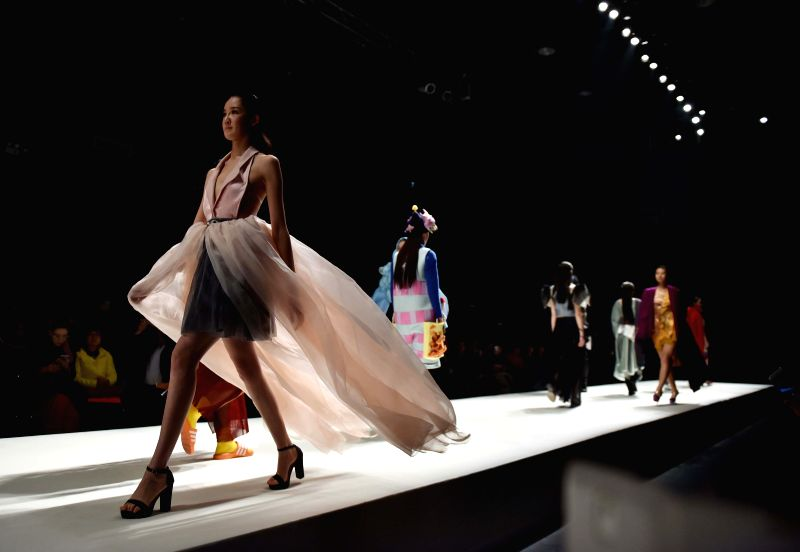"""Models present fashion creations designed by graduates of Beijing Institute of Fashion Technology during the """"Already Here"""" fashion week in Beijing, ..."""