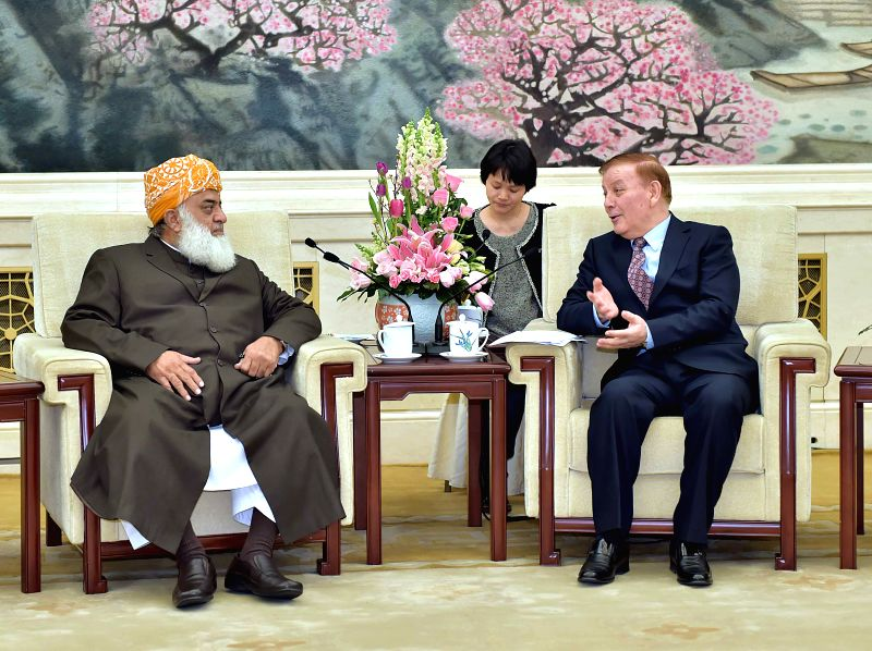 Arken Imirbaki, vice chairman of the Standing Committee of China's National People's Congress (NPC), meets with Maulana Fazal-ur-Rehman, head of Pakistan's ...