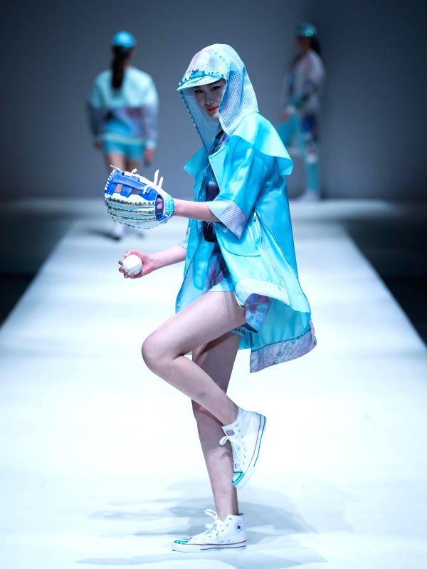 A model presents a creation designed by graduates of Beijing Institute of Fashion Technology at a fashion show in Beijing, capital of China, March 19, 2015. ...