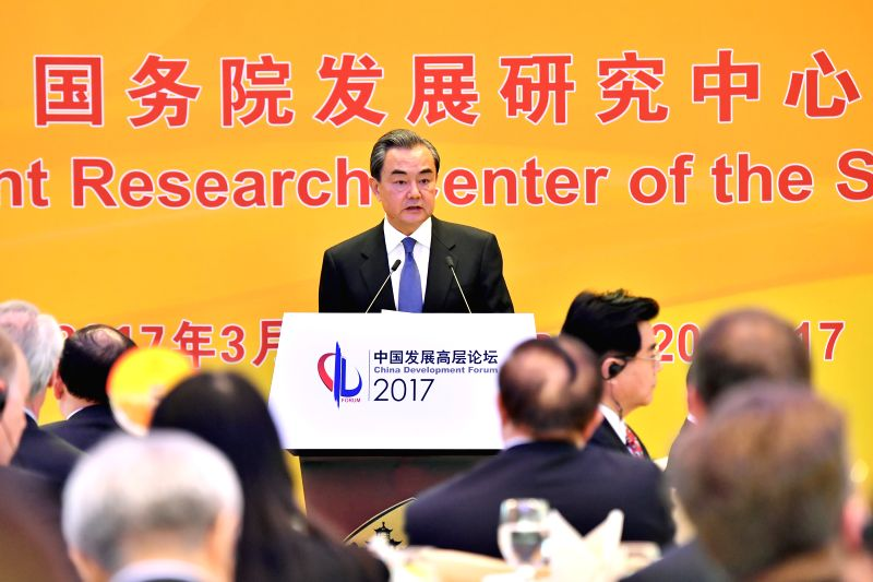 BEIJING, March 20, 2017 - Chinese Foreign Minister Wang Yi delivers a speech at the China Development Forum 2017 in Beijing, capital of China, March 20, 2017.  (Xinhua/Li Xin) - Wang Y