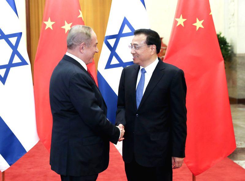 BEIJING, March 20, 2017 - Chinese Premier Li Keqiang (R) holds talks with Israeli Prime Minister Benjamin Netanyahu in Beijing, capital of China, March 20, 2017. - Benjamin Netanyahu
