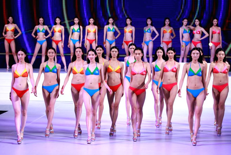 Contestants present swimsuits during the 10th China Super Model Final Contest in Beijing, capital of China, March 23, 2015. - Final Contest