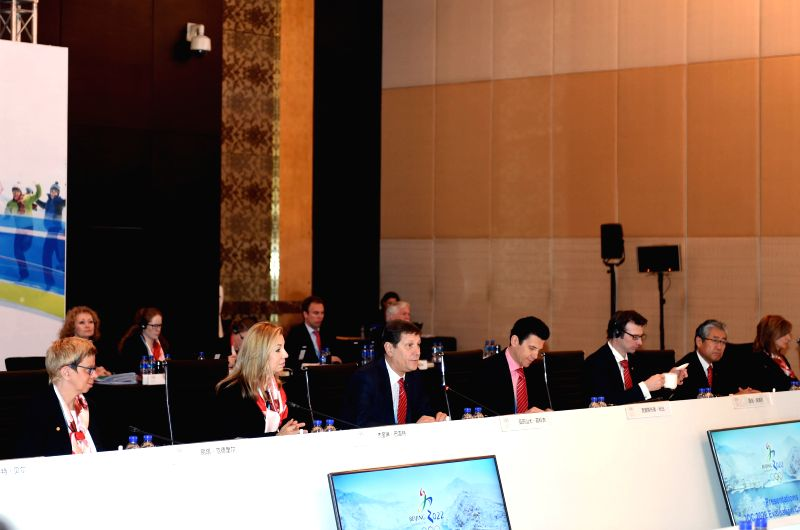 Members of the International Olympic Committee's (IOC) Evaluation Commission attend the opening ceremony of the official presentation meeting, in Beijing, capital ...