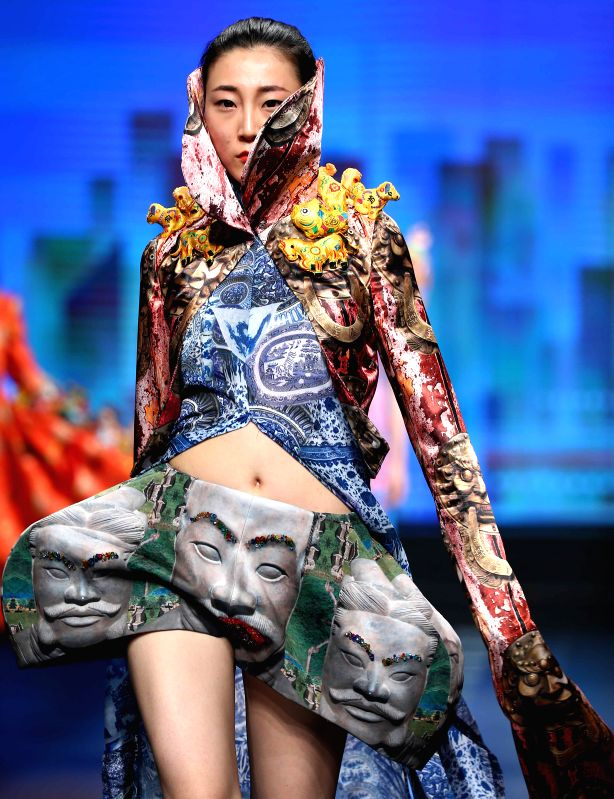 A model presents a creation at the opening ceremony of the China Fashion Week Autumn/Winter Collection in Beijing, capital of China, March 25, 2015. The fashion ...