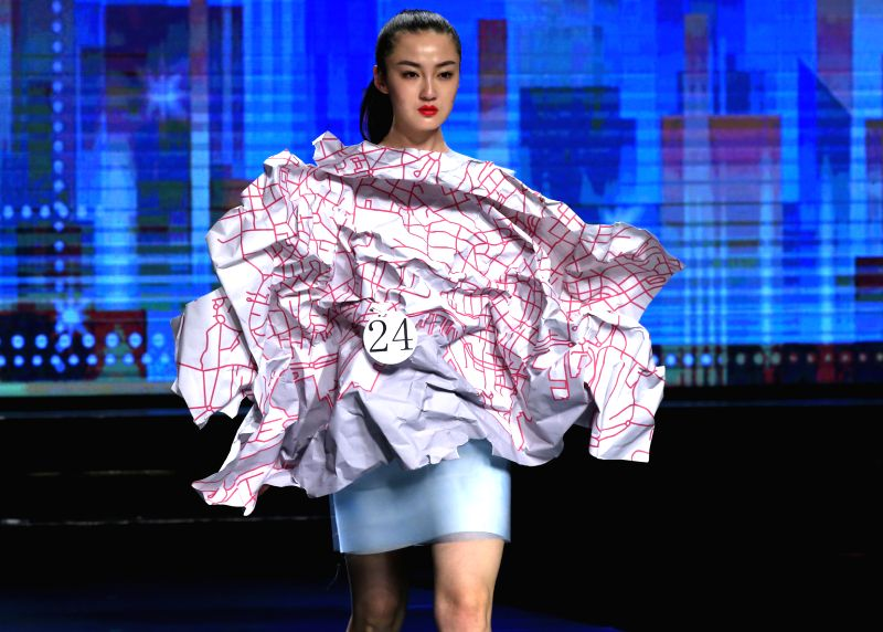 "A model presents a creation during the 23rd China International Young Fashion Designer Contest, the ""Hempel Award"", in Beijing, capital of China, March ..."