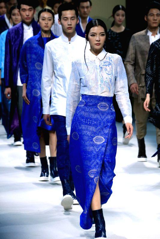 A model presents fashion creations designed by Zeng Fengfei during the Zeng Fengfei Solo Fashion Show of ASAHI KASEI Chinese Fashion Designer Creativity Award in ...