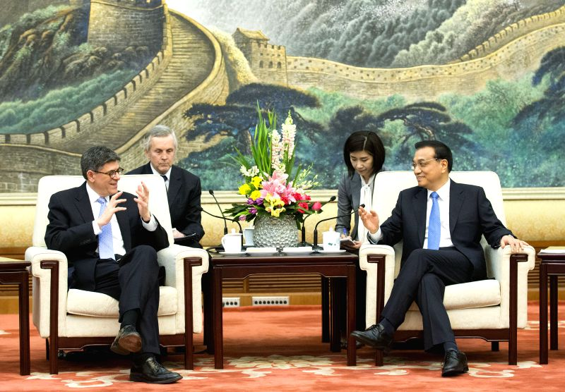Chinese Premier Li Keqiang (R) meets with Treasury Secretary of the United States Jacob Lew in Beijing, capital of China, March 30, 2015. (Xinhua/Huang Jingwen) ...