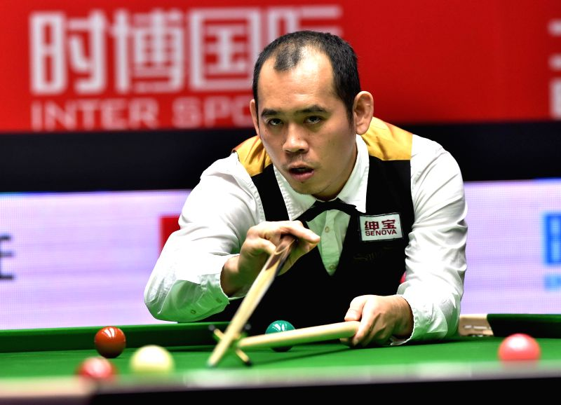 Dechawat Poomjaeng of Thailand competes during the first round match against Neil Robertson of Australia at the 2015 World Snooker China Open in Beijing, capital ...