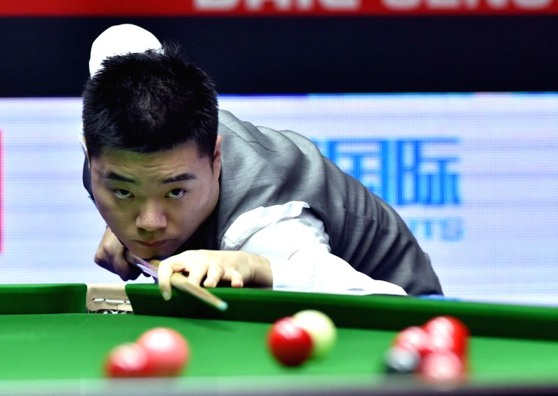 Ding Junhui of China competes during his first round match against Marcus Campbell of Scotland at the 2015 World Snooker China Open in Beijing, capital of China, ... - Marcus Campbell