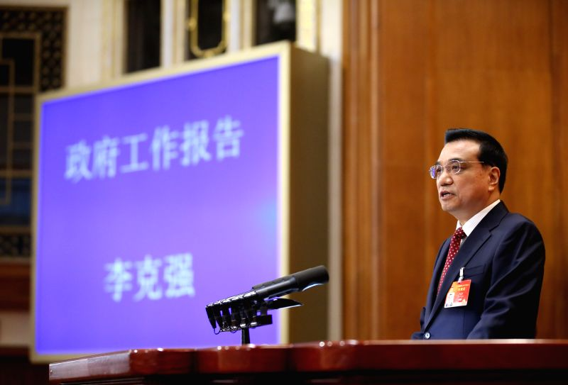 Chinese Premier Li Keqiang delivers the government work report during the opening meeting of the third session of China's 12th National People's Congress (NPC) at ...