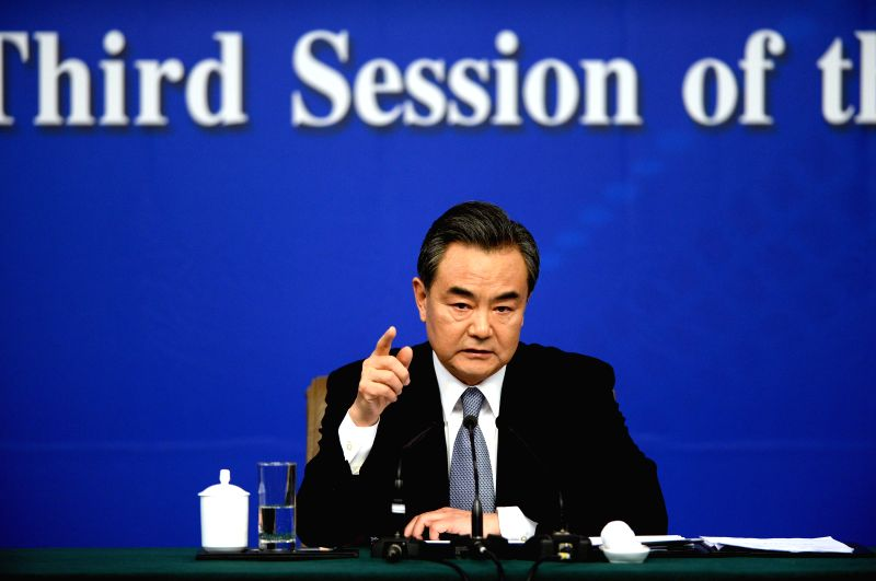 Chinese Foreign Minister Wang Yi gives a press conference for the third session of China's 12th National People's Congress (NPC) in Beijing, capital of China, March ... - Wang Y