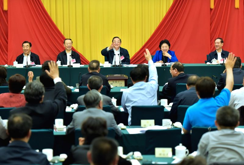 BEIJING, May 10, 2016 - Yu Zhengsheng(3rd L back), chairman of the National Committee of the Chinese People's Political Consultative Conference (CPPCC), presides over a symposium on deepening reform ...