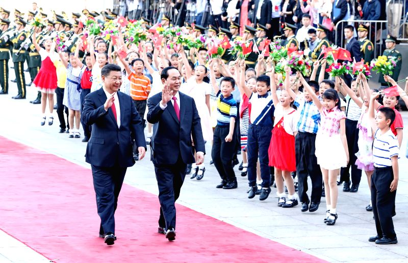 BEIJING, May 11, 2017 - Chinese President Xi Jinping (R) and Vietnamese President Tran Dai Quang witness the signing of a series of bilateral cooperation agreements after their talks in Beijing, ...