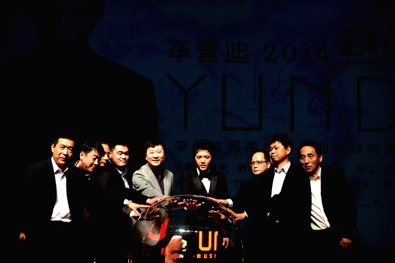 Chinese pianist Li Yundi (4th R) and honored guests attend a launching ceremony for his 2014 tour in China at Beijing, capital of China, May 12, 2014. Li Yundi will .