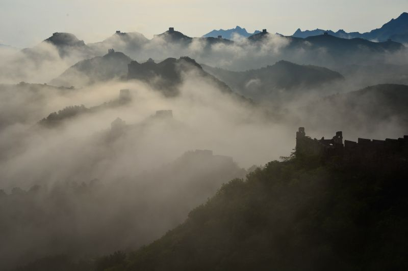 Photo taken on May 12, 2014 shows clouds over the Jinshanling Great Wall in Beijing, capital of China.