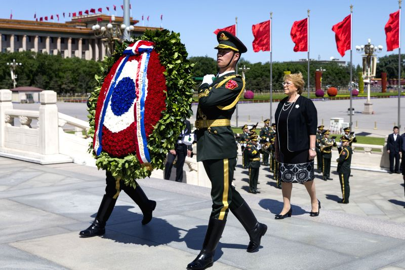 BEIJING, May 13, 2017 - Chilean President Michelle Bachelet offers a wreath to the Monument to the People's Heroes at the Tian'anmen Square in Beijing, capital of China, May 13, 2017.