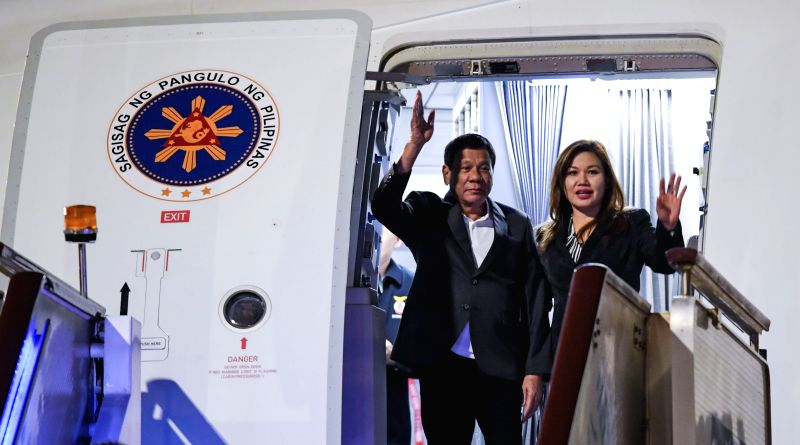 BEIJING, May 13, 2017 - Philippine President Rodrigo Duterte (L) arrives in Beijing, capital of China, May 13, 2017, to attend the Belt and Road Forum (BRF) for International Cooperation.